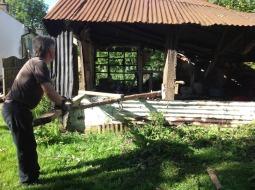 Demolishing the old barn